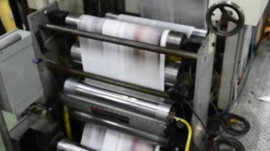 Print press hit set roll paper goes through the rollers after passing the printing units — Stock Video
