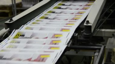 Print plant factory, magazine line collecting after passing the press rollers into printing units and folder — Stock Video