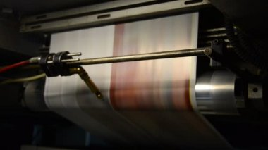 Offset print press hit set roll paper goes through the rollers and is read by the color management camera, after passing the printing units — Stock Video