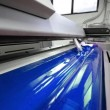 Stock Video: Cyen, Blue on offset print press machine wide angle