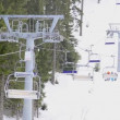 Stock Video: Ski resort, chair ski lift elevator lifting on the mountain ski slope