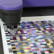 Stock Video: Press shop, spectrophotometer robot measurement of color patches in prepress on Test Arch