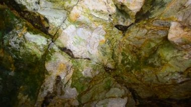 Heaven and hell underground Green deep cave colorful stones — Stock Video