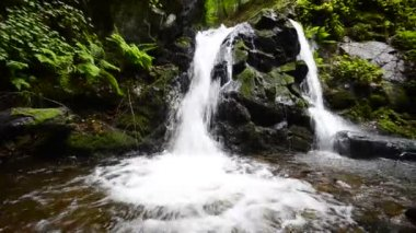 Waterfall wide angle subtle dolly, bottom shoot panning — Stock Video