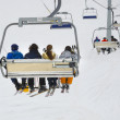 Chair ski lift elevator lifting people — Stock Photo #48242783