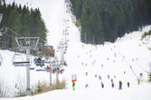 Ski resort chair ski lift elevator lifting people — Foto Stock