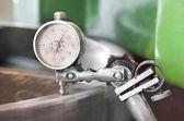 Metal workshop cogwheel dial gauge instrument inclination measurement — Stock Photo