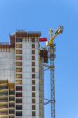 Cranes on the skyscraper construction site — Stock Photo