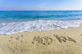 Word MISS YOU drawn on the sand of a beach — Fotografia Stock