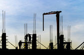 Building skyscraper construction site silhouette crane working filling the posts with concrete — Stock Photo