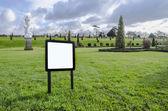 Blank notice Board on the lawn garden — Stock Photo