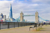 The Shard and Tower Bridge with an empty bench in London, UK — Stock Photo