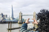Girl takes picture with smartphone in London, UK — Photo