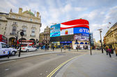 People at Piccadilly Circus in London — Stock Photo