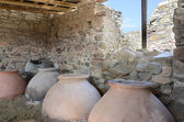 Old clay pot excavations into ancient city ruins — Stock Photo