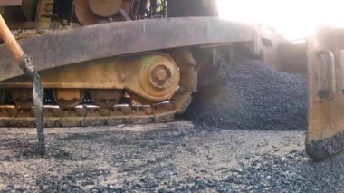 Asphalt laying machine dropping blacktop tar — Stock Video