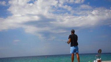Fisherman throws fishing tackles — Stock Video
