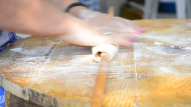 Grandmother prepares pastry on wooden table — Stock Video