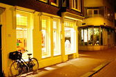 Bike on a shop at night — Stock Photo