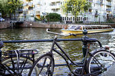 Bike and boat in amsterdam — Stock Photo