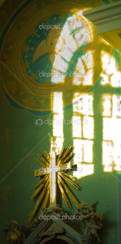 Cross in a shaft of light  — Stock Photo #13614103