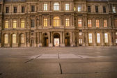 Windows at night in cour carre paris — Stock Photo