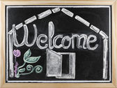 Welcome message written in a blackboard — Stock Photo