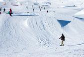 Snowboarder at snowpark — Stock Photo