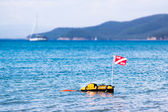 Floating scuba presence buoy — Stock Photo
