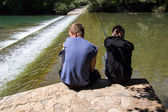 Two boys near the river — Stock Photo