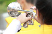 Girl musicians blowing trumpets — Foto Stock