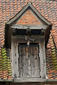 Dormer with wood door and pulley — Stock Photo