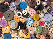 Pile of old and used clothes buttons — Stock Photo
