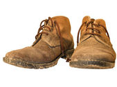 Old and dirty worn out working boots — Stock Photo