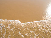 Sun mirrored in the wet sand beach at summer — Stock Photo
