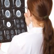 Female doctor examining a brain cat scan — Stock Photo #13301626