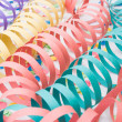 Several colourful party paper ribbons and confetti — Stock Photo #13306478