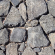 Basalt (volcanic rock) wall made with irregular blocks. — Foto Stock