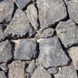Basalt (volcanic rock) wall made with irregular blocks. — Stockfoto