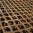 Royalty-Free Stock Photo: Old and rusty metal grid background texture