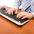 Man typing in the computer keyboard — Stock Photo