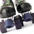 Retro roller skates isolated on white background - Stock Photo
