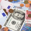 Euro and Dollar bills and coins. Monetary war. — Stockfoto