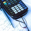 Scientific Calculator with exercise books and glasses — Stock Photo