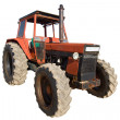 Old red rusty tractor with dirty wheels — Stock Photo
