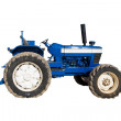 Old blue rusty tractor with dirty wheels — Stock Photo