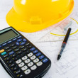 Building projects with architect drawing and protective tools — Stock Photo