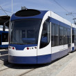 Modern tram parked at the metro station — Stock Photo