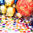 Christmas background with balls, ribbons and confettis — Stock Photo