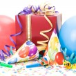 Stock Photo: Gift, party hats, horns or whistles, confettis and balloons on white background.